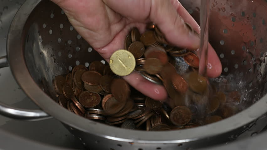 Money laundering concept, washing coins in the duster, water running out of faucet in the sink | Shutterstock HD Video #1018172050