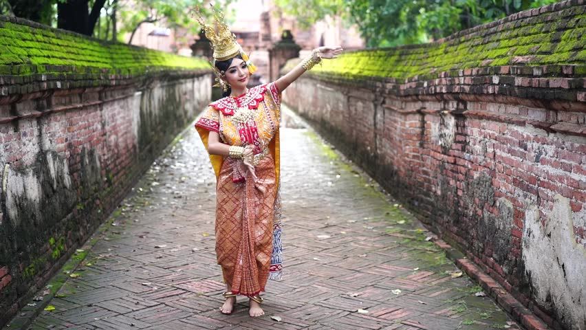 Thailand traditional or cultural dance. Thai beautiful girl is dancing called Ram, it is noble Thai art of elegance. Royalty-Free Stock Footage #1018191121