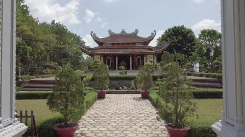 2K Aerial close-up view of historical asian buddhist temple in Bao Loc. Zen buddhist pagoda in Vietnam. Beautiful gates of an old temple