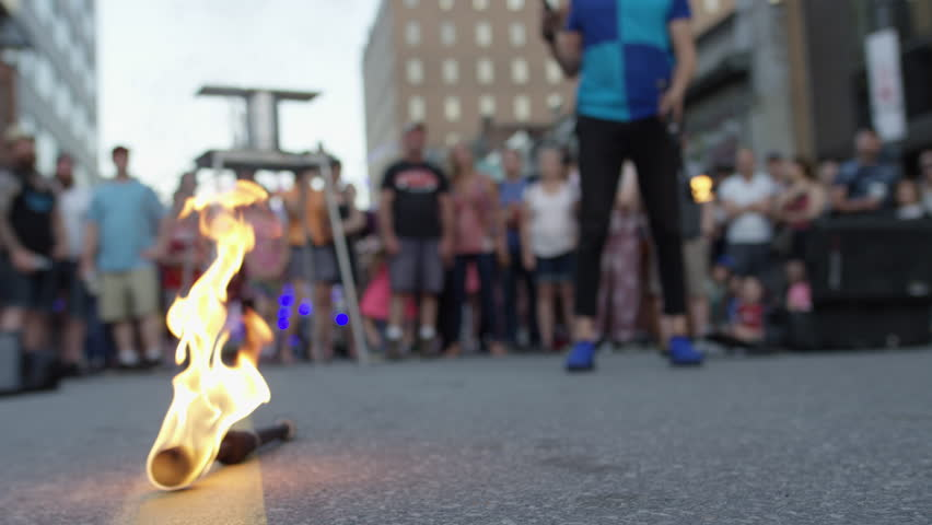 Ottawa, Ontario / Canada - 06 25 2018: A juggler performs in front of a crowd at Ottawa's annual Glow Fest on Bank Street #1018227298