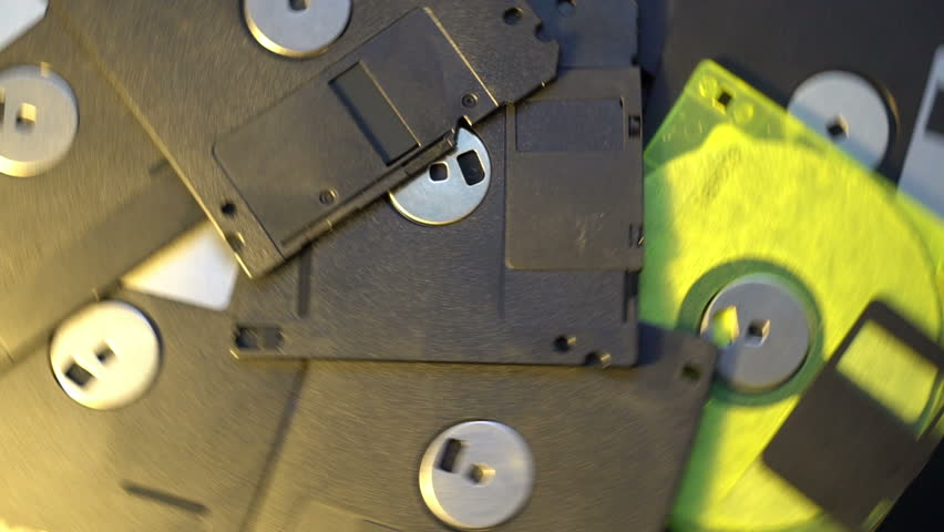Pile of old style data transfer floppy discs, rotating spinning background | Shutterstock HD Video #1018228507