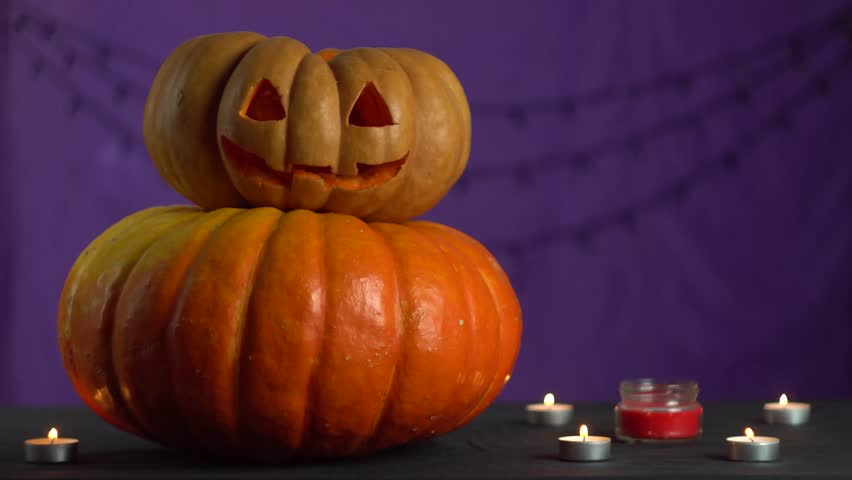 Female hands light a candle and put it inside a pumpkin for halloween | Shutterstock HD Video #1018236628