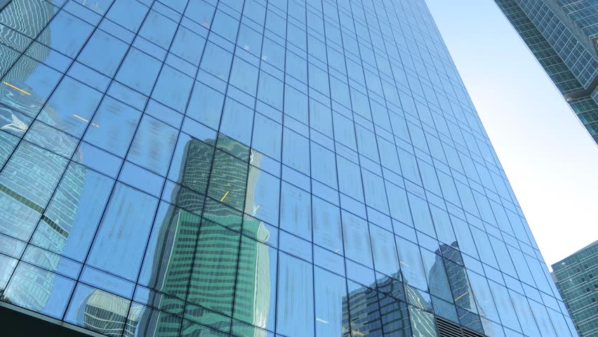 Moving among skyscrapers. Modern office building. Glass and reflections. Steadicam shot | Shutterstock HD Video #1018241941