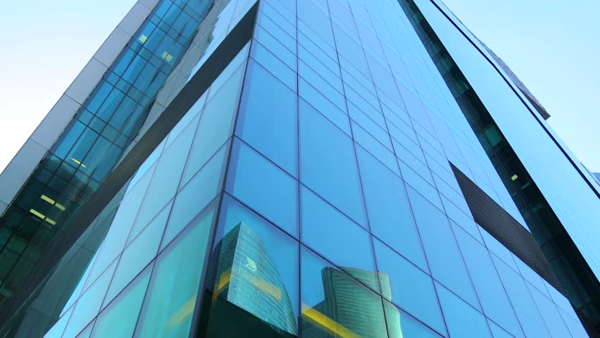 Moving among skyscrapers. Modern office building. Glass and reflections. Steadicam shot | Shutterstock HD Video #1018241953