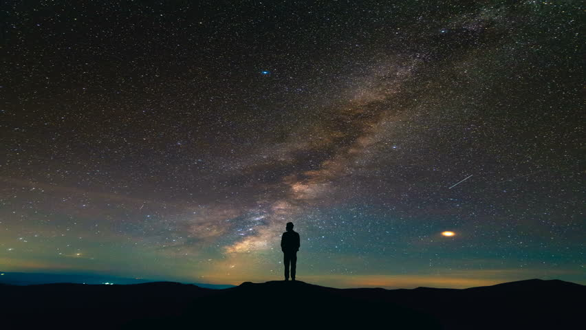 The man standing on the meteor shower background. time lapse #1018268572