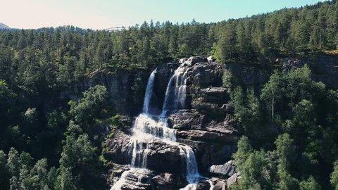 Drone shot descending down waterfall in Norway.
