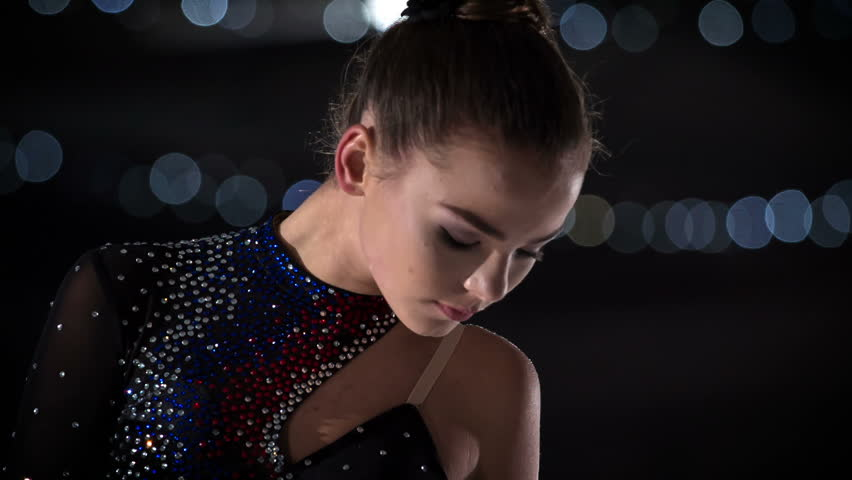 A figure skater lifts her head up and her performance is about to start.   Shutterstock HD Video #1018282462