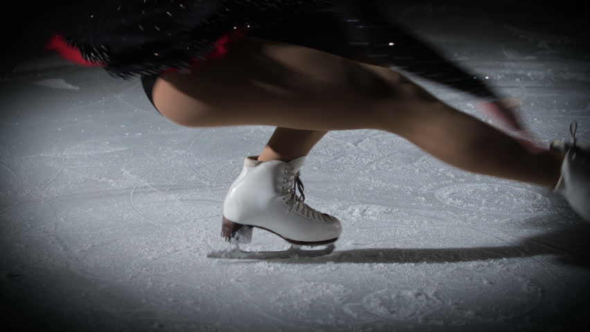 This talented young figure skater is keeping her balance when she spins on the ice.   Shutterstock HD Video #1018282471