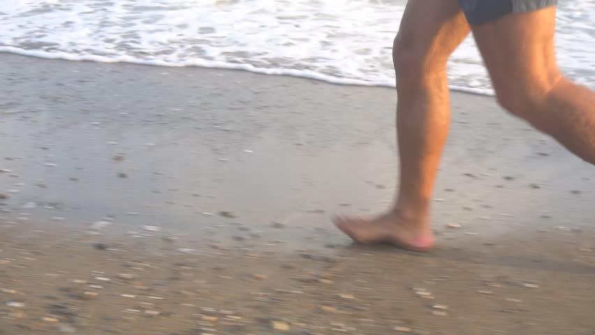 Man Running On Beach At Sunrise. | Shutterstock HD Video #1018313317
