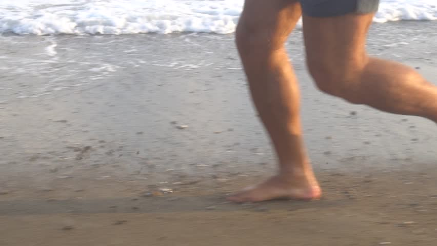 Man Running On Beach At Sunrise. | Shutterstock HD Video #1018313326