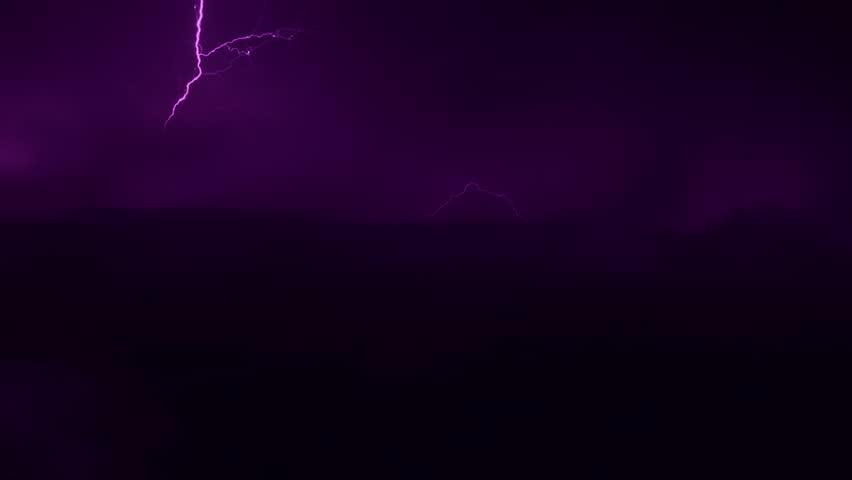 Lightning strike bolt in horizon, nature thunder storm clouds time lapse, danger power, dark night supercell time.