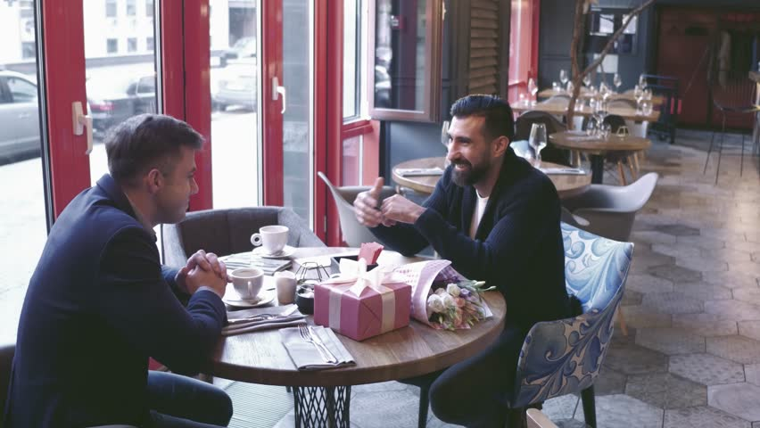 Two men sitting at the cafe | Shutterstock HD Video #1018329670