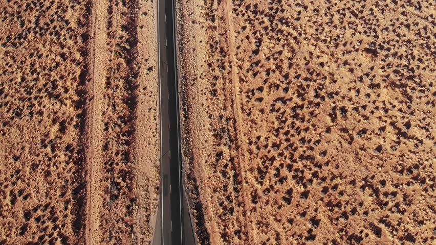 Aerial view of Desset Road, car passing by, Monument Valley, 4k drone footage | Shutterstock HD Video #1018345843