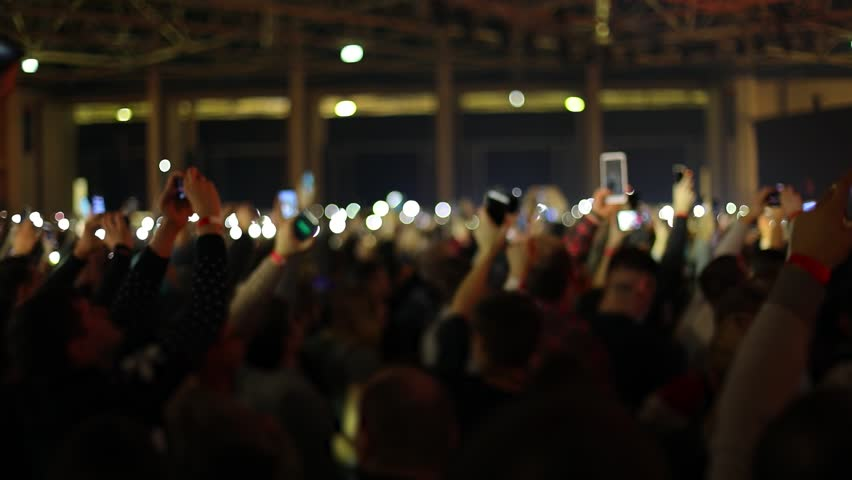 People waving hands with smartphones with flashlight. Live music concert. Slow motion, steadicam shot | Shutterstock HD Video #1018379812
