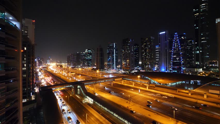 Scenic view at night with traffic in Jumeirah Lake Towers. Dubai, UAE. | Shutterstock HD Video #1018383343