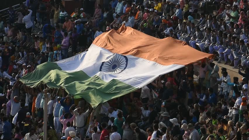 Amritsar, Panjab/india-oct 2018: Most spectacular flag ceremony in wagah border India, crowd passing Indian flag.