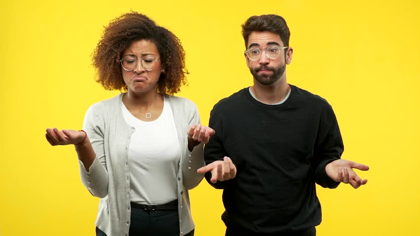 Young african american woman and caucasian man doubting and shrugging shoulders, concept of indecision and insecurity