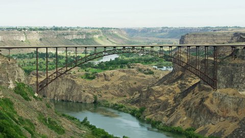 Aerial view of Twin Falls Idaho the Perrine Bridge US Highway 93 Snake River Canyon Highway transport traffic America RED WEAPON