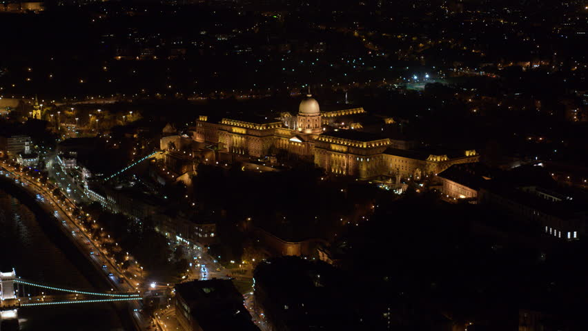 Aerial view of the Buda Castle and Chainbridge in downtown Budapest at night - drone 4K video   Shutterstock HD Video #1018452271