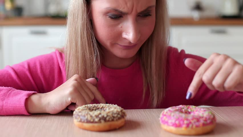Woman wants to eat donuts at home   Shutterstock HD Video #1018528858