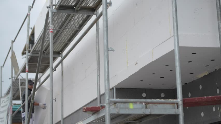 Contractor on Metal Scaffolding with Insulation Block. | Shutterstock HD Video #1018534234