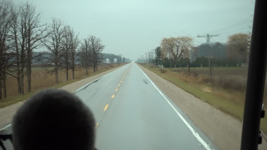 4K Close Up Bus Drivers Head While Driving Down Side Country Road On Rainy Da | Shutterstock HD Video #1018547023