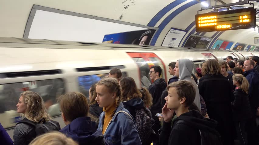 London, England-1 October,2018: The Underground or The Tube inside view of London underground in rush hours. Overcrowded trains in the central city.