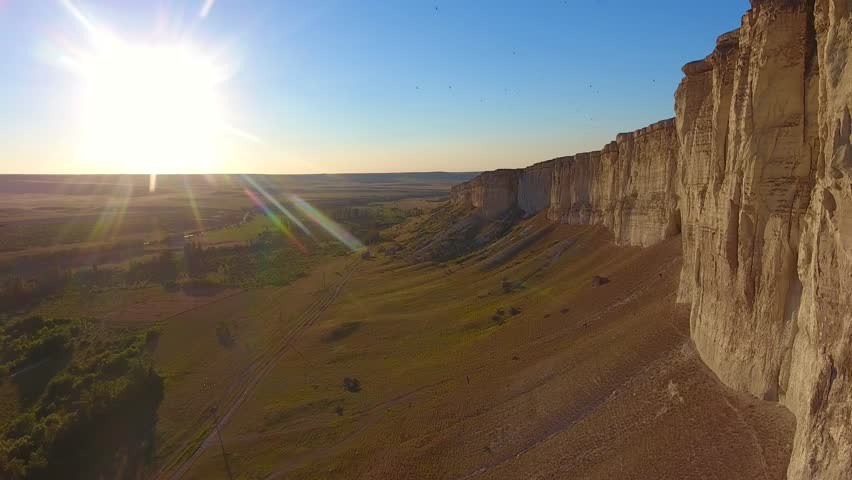 White Rock Canyons sunset rays shine flight going in between high rocks birds fly around active structures flying in circle camera authentic view top. Aerial view western style. | Shutterstock HD Video #1018604890