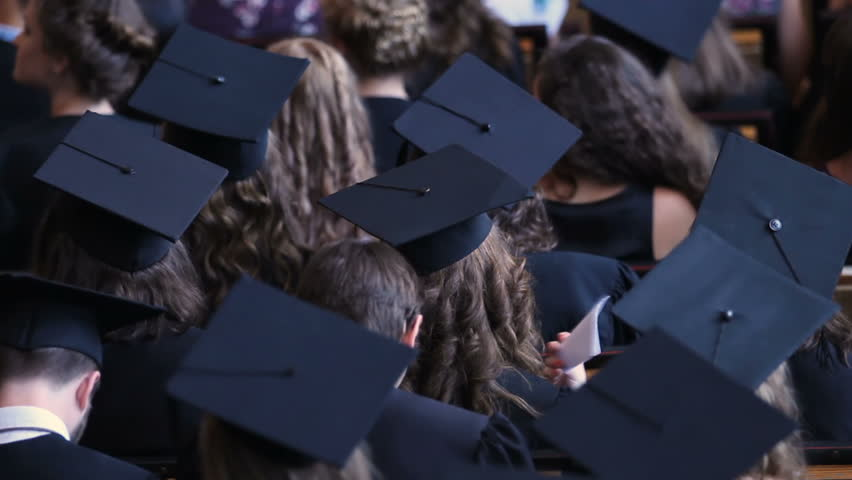 Back view of graduating students in academic caps, diploma awarding ceremony | Shutterstock HD Video #1018619659
