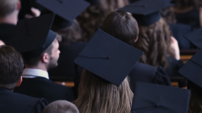 Many graduates applauding at graduation ceremony, future of national economy | Shutterstock HD Video #1018619671