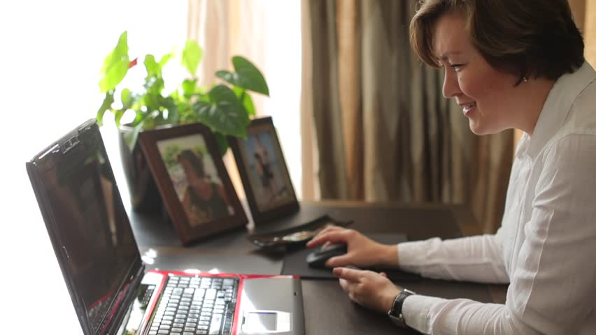 Business transformation due to COVID-19 world pandemic. Woman work from home with laptop and studies variations in organizations as new technologies are introduced. Telecommuting concept. Royalty-Free Stock Footage #1018639009
