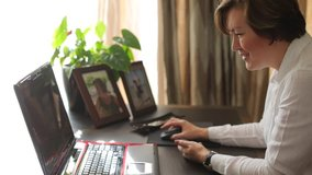 Business transformation due to COVID-19 world pandemic. Woman work from home with laptop and studies variations in organizations as new technologies are introduced. Telecommuting concept.
