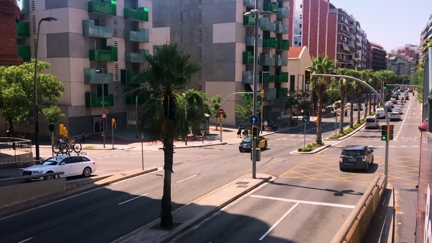 Barcelona, Spain - 08 06 2018: Street of Barcelona, Spain, August, sunny day, busy street. | Shutterstock HD Video #1018658548