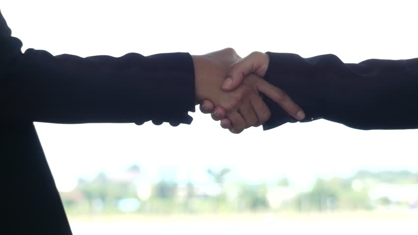 Business Shake hands on white background, video hold one's hands, | Shutterstock HD Video #1018676599