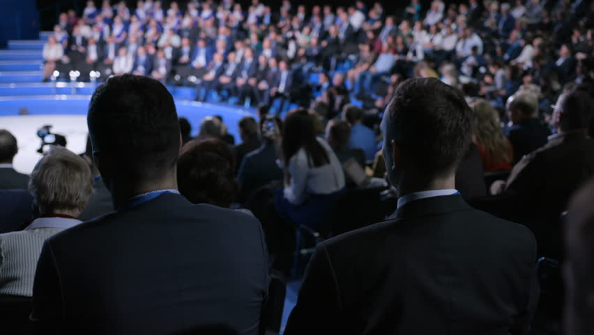Crowd at official congress for cooperation solution or modern education. Economic concept of strategy briefing for partner or politician team. Row of seats in large room for listener or spectator | Shutterstock HD Video #1018680304
