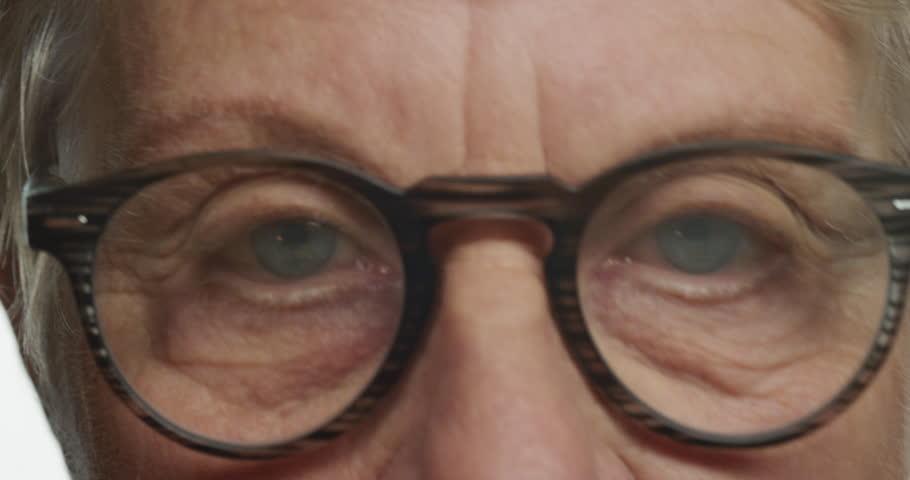 Close up eyes elderly woman wearing glasses looking tired eye strain concept   Shutterstock HD Video #1018689076