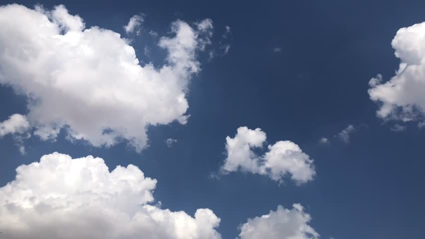 Cloudy time lapse 4k Seamless Loop Clouds,Towering Cumulus 4k Cloud Billows Time Lapse Seamless Beautiful white cloudscape soar across the screen time lapse fashion over a deep blue background 4k UHD