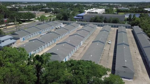 Aerial flyover drone footage of public storage unit property showing landscape in background