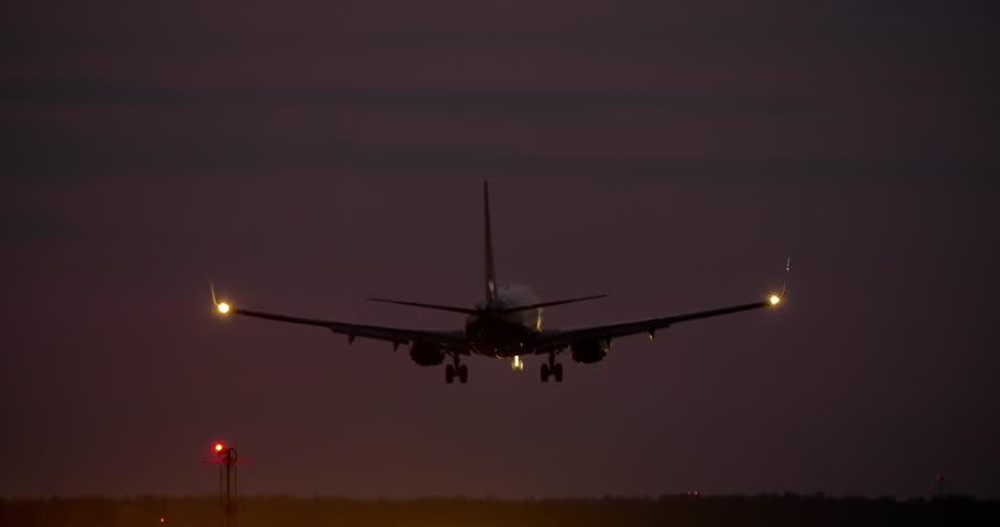 4K - Airplane landing at night on runway