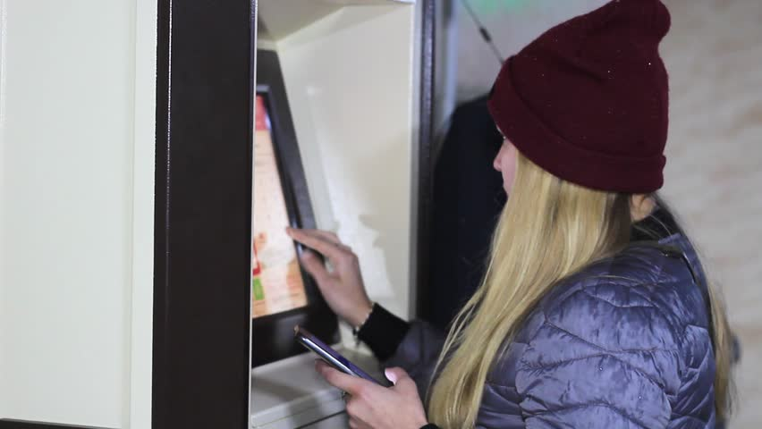 girl at an ATM uses a card Royalty-Free Stock Footage #1018723108