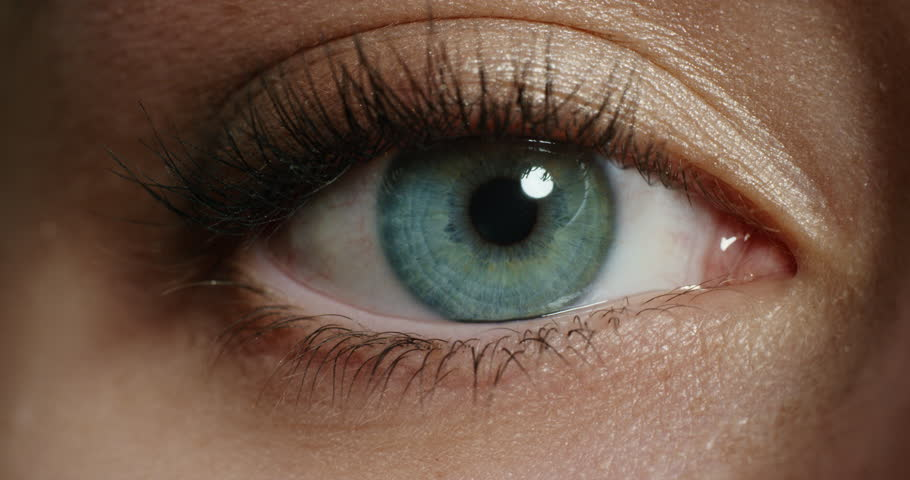 Close up beautiful blue eye opening human iris macro natural beauty | Shutterstock HD Video #1018748461