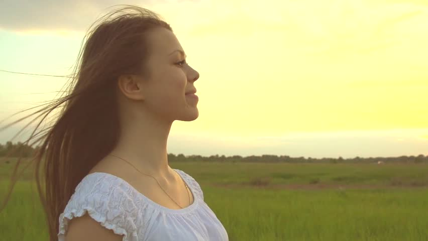 Beauty Girl with Healthy Long Hair Outdoors. Happy Smiling Young Woman Enjoying Nature. Beautiful Young Woman having Fun in the Meadow. Freedom concept. Sunset    Shutterstock HD Video #10187489
