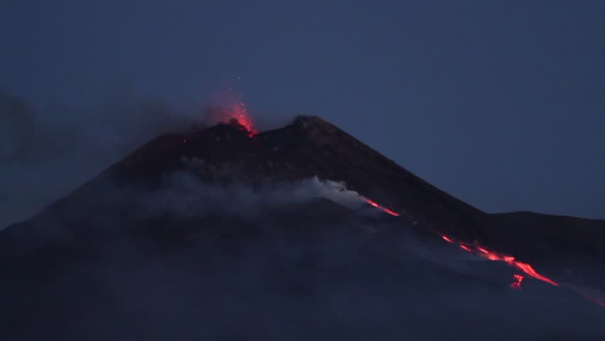 Volcano Etna eruption - Explosion and lava flow in Sicily   Shutterstock HD Video #1018755646