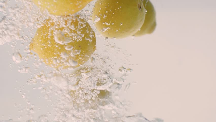 Concept Background: Lemons Slowly Fall Into The Water | Shutterstock HD Video #1018759696