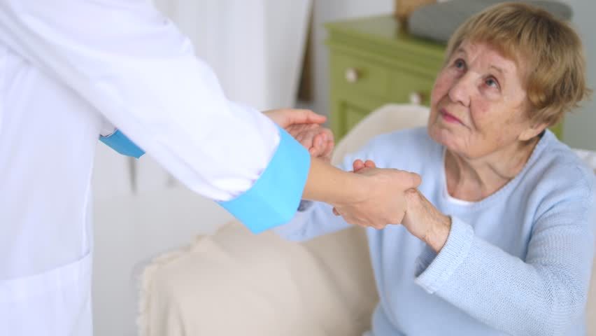 Doctor Helping Senior Woman. Elderly Care.