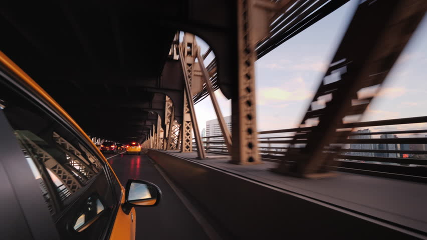 The famous New York yellow cab rides over the bridge. View from the taxi window