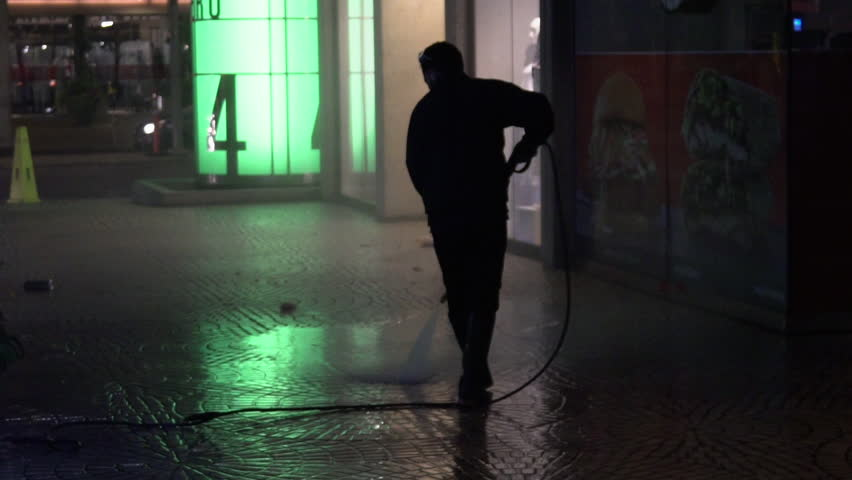 San Francisco, California / USA - August 9, 2018: Silhouetted man power washes the sidewalk at night in San Francisco | Shutterstock HD Video #1018791718