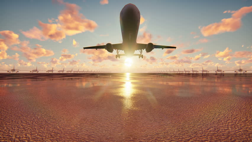 Plane takes off at sunrise background in slow motion #1018801705