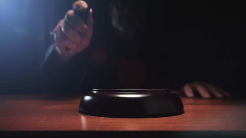Judge hitting Gavel off a block in courtroom, dark background slow motion dolly shot Royalty-Free Stock Footage #1018835032