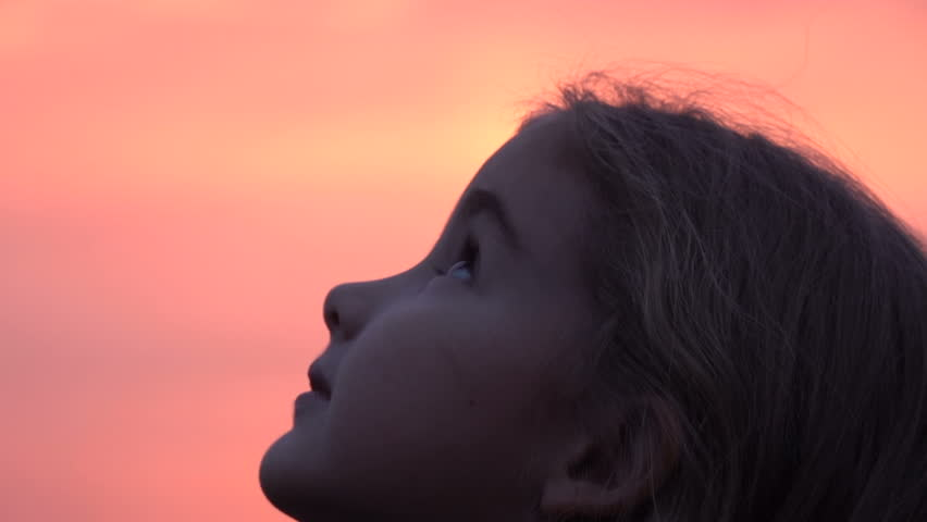 Kid looking up at the sky in nature. Little girl praying looking up at purple sky with hope, close-up.  Royalty-Free Stock Footage #1018841071